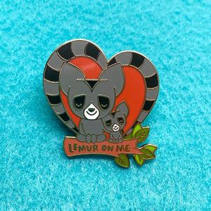 """Lemur On Me"", 1.35 inches tall heart shape hard enamel pin with gold plating. Lean On Me. Valentine's Day gift, Romance, Romantic gift, friendship, positive affirmation, inspirational message, woodlawn animals, kawaii cute, Penguins of Madagascar"