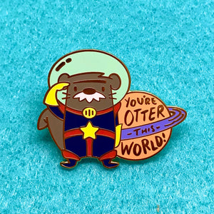"""You're Otter This World!"",  1.25 inches tall, hard enamel pin with gold plating. Out of This World. Valentine's Day gift, Romance, Romantic gift, friendship, positive affirmation, inspirational message, woodlawn animals, kawaii cute"