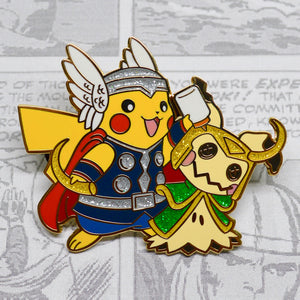 Gold enamel pin of Thor (Pikachu) and Loki (Mimikyu) from the Avengers and Pokemon! Pikachu enamel pin, Mimikyu enamel pin, Thor enamel pin, Loki enamel pin, Chris Hemsworth, Tom Hiddleston, Raichu enamel pin, Jane Foster, Ash Ketchum enamel pin, Natalie Portman, Stormbreaker enamel pin, Thor The Dark World, Thor Ragnarok, Thor Love and Thunder, Valkyrie, Mjolnir enamel pin, Odin, Asgard