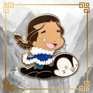Avatar - The Last Airbender Katara hard enamel pin with penguin otter, 1.75 inches tall, gold plating. Aang, Appa, Toph, Bumi, Azula, Sokka, Momo, Zuko, Uncle Iroh, White Lotus, Fire Nation, Water Tribe, Earth Kingdom, Ba Sing Se, earth bending, fire bending, air bending, water bending