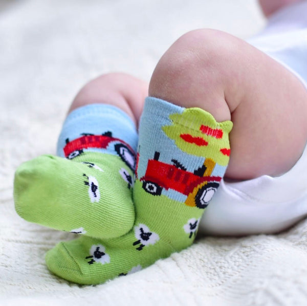 baby feet in sheep socks