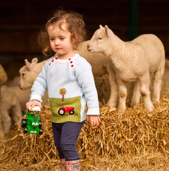little girl wearing sheep crew neck jumper