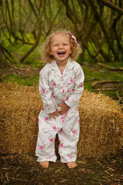 little girl wearing floral pyjamas - the baby gifting co