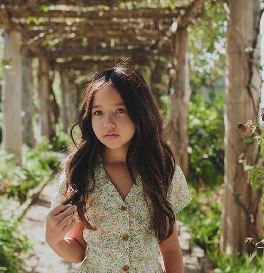 vines green dress green eyes dark hair old fashion dress summer time spring time tanned skin brown buttons children's fashion little girl outwear