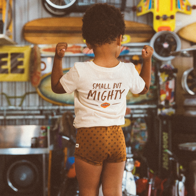 Little boy with strong muscles wearing My Brother John boys retro Tee and brown mustard Vegemite toast nappy covers.