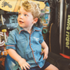 Blonde vintage boy wearing a retro denim collared shirt by My Brother John Australian kids clothing label.