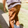 Boy skateboarding showing Vegemite badges on Jamie Trousers from Vegemite collection