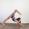 Girl in yoga pose wearing gymnastics clothing by Australian kids sportswear brand Chasing Oso