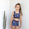 girls activewear crop and sorts set in dark blue with floral bird print by Chasing Oso