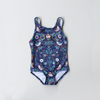 Songbird girls gymnastics leotard by Chasing Oso. Acro training leotard in blue bird and floral print