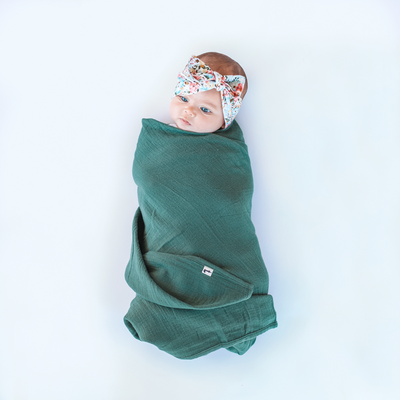 Deep green pretty girls baby wrap swaddle by lacey lane. Soft pretty green baby swaddle for girls and boys by lacey lane & my brother john