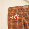 Close up faltlay of Vegemite badges on the back pocket of Jamie Trousers from the Happy little vegemite collection