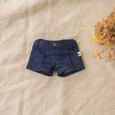 Mini My Brother John Doll dark denim doll tuckers flatlayed on a natural background