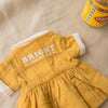 Back picture of Lacey Lane 1960's dolls dress with Vegemite slogan