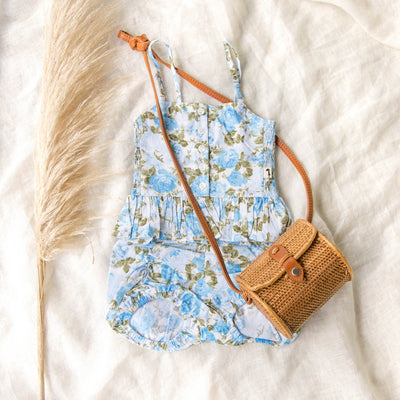 flatlay of new lacey lane blue floral cami & puckers
