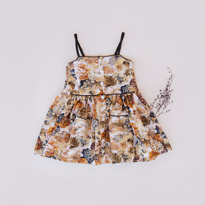 lacey lane pepita dress flatlayed. Pretty vintage inspired little girls dress by lacey lane