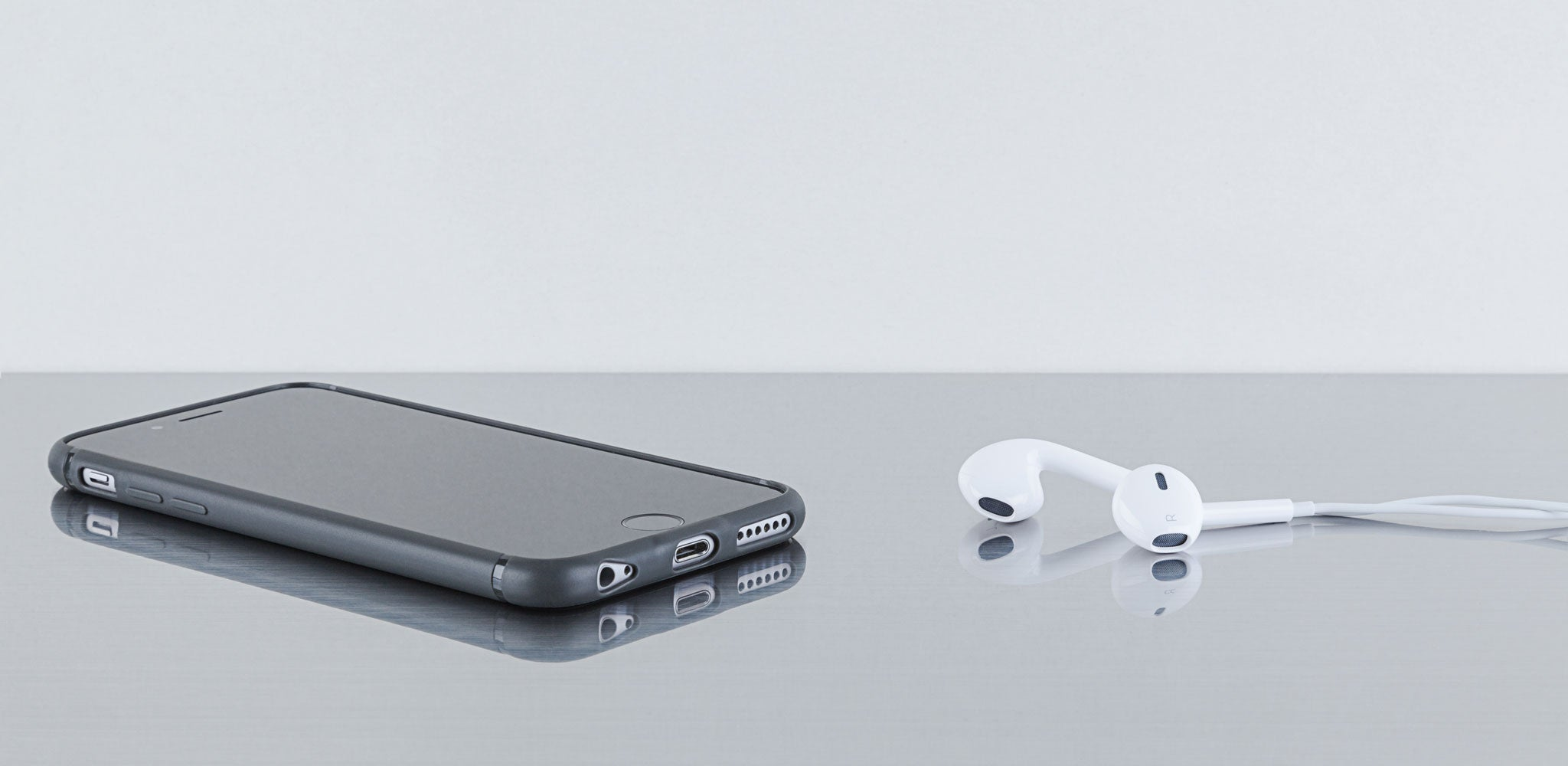 The Sheath | Super slim, shock-absorbing, minimalist iPhone case | earbuds