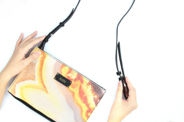 Cross-body bag with detachable shoulder strap