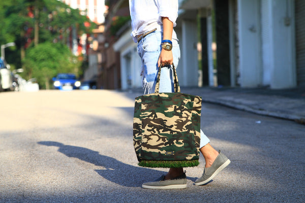 The coolest travel bag for him and her in green camouflage pattern and astroturf