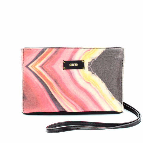 Pink crossbody bag and clutch by GLUSH