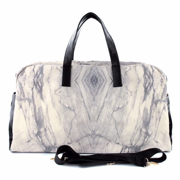 Stay chic with this white marble bag with your outfit. Bring it to gym, work, or travel. Designed by GLUSH/