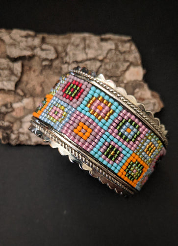 Handcrafted Metal Cuff bracelet with a multicolored beaded panel