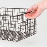 Heavy duty mdesign farmhouse vintage metal wire storage basket bin with handles for organizing closets shelves and cabinets in bedrooms bathrooms entryways and hallways 4 pack bronze
