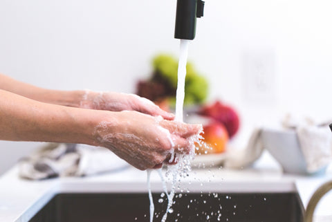 washing-hands-under-sink-faucet-kitchen