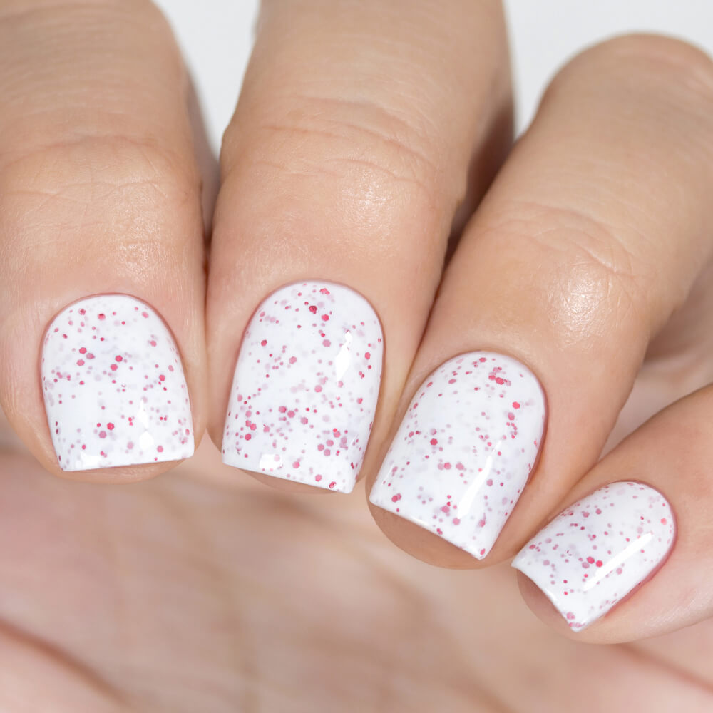 Masura Sugar Cranberry white nail polish with red glitter swatch Winter Holidays Collection