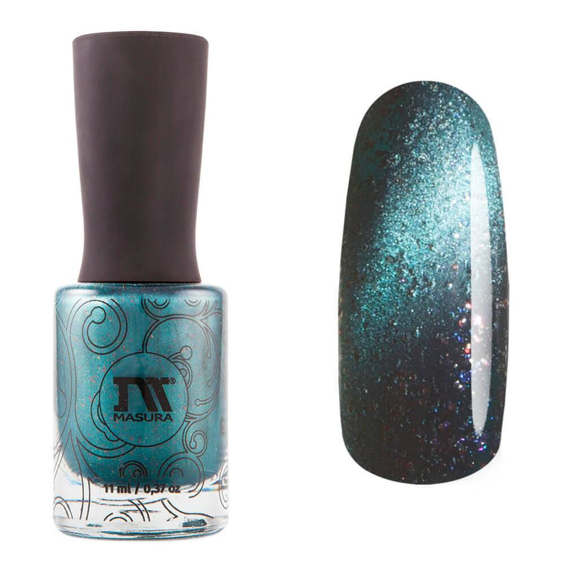 Masura Fantasy Wood is a teal magnetic nail polish with shimmering red & blue-violet flakes