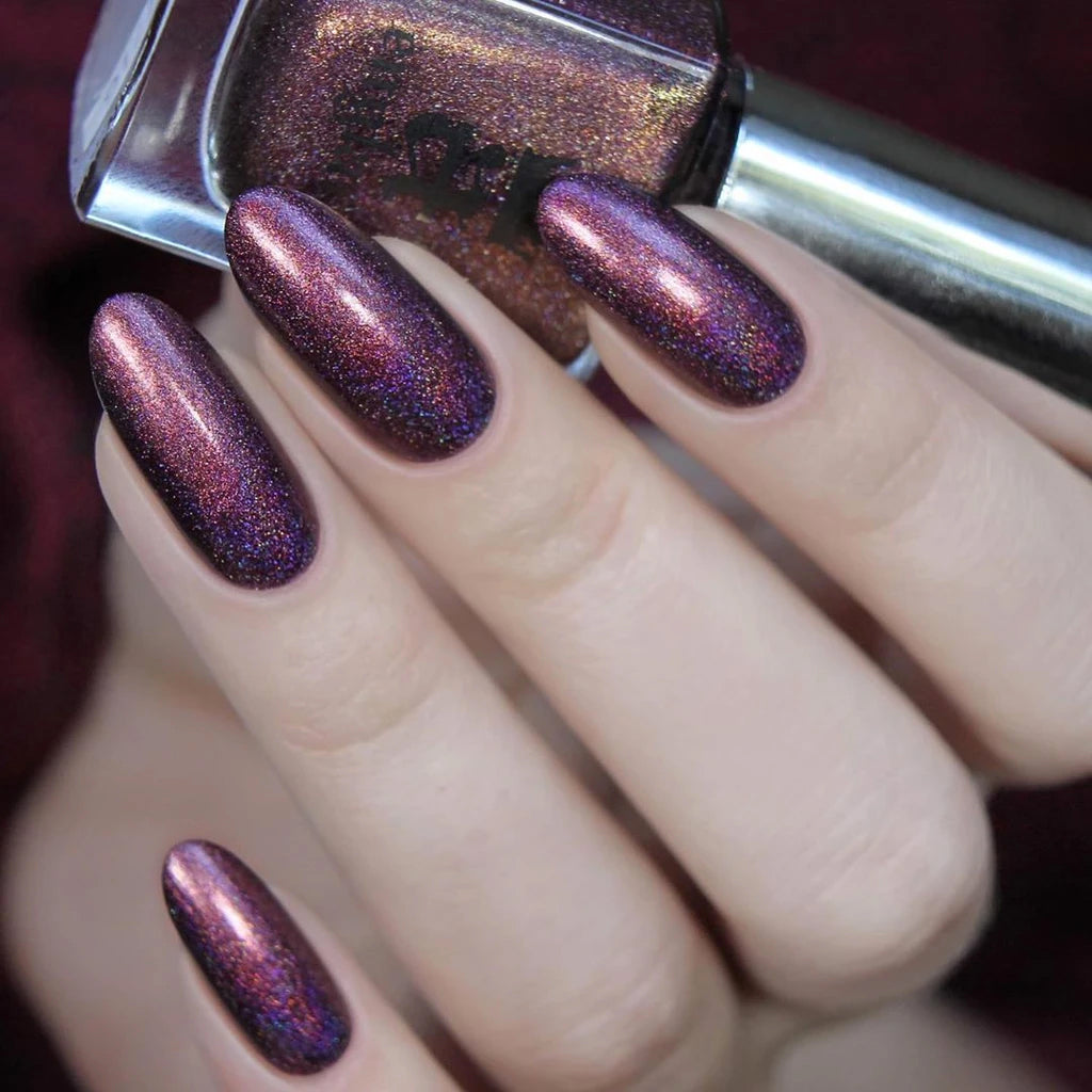A-England Crown Jewels burgundy holographic nail polish with a fine golden lustre