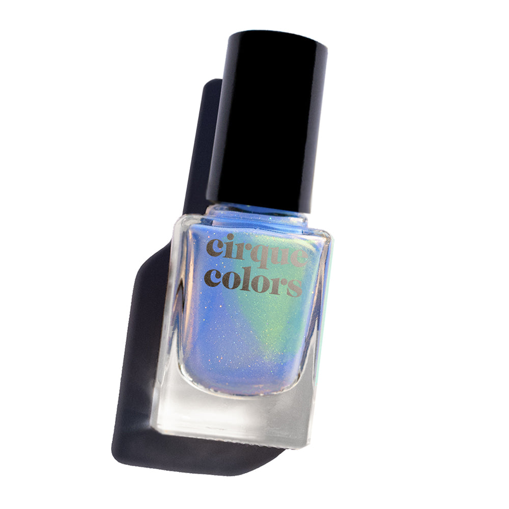 Cirque Colors Anchors Away periwinkle blue nail polish with glowing green shimmer and delicate holographic sparkle Resort Collection
