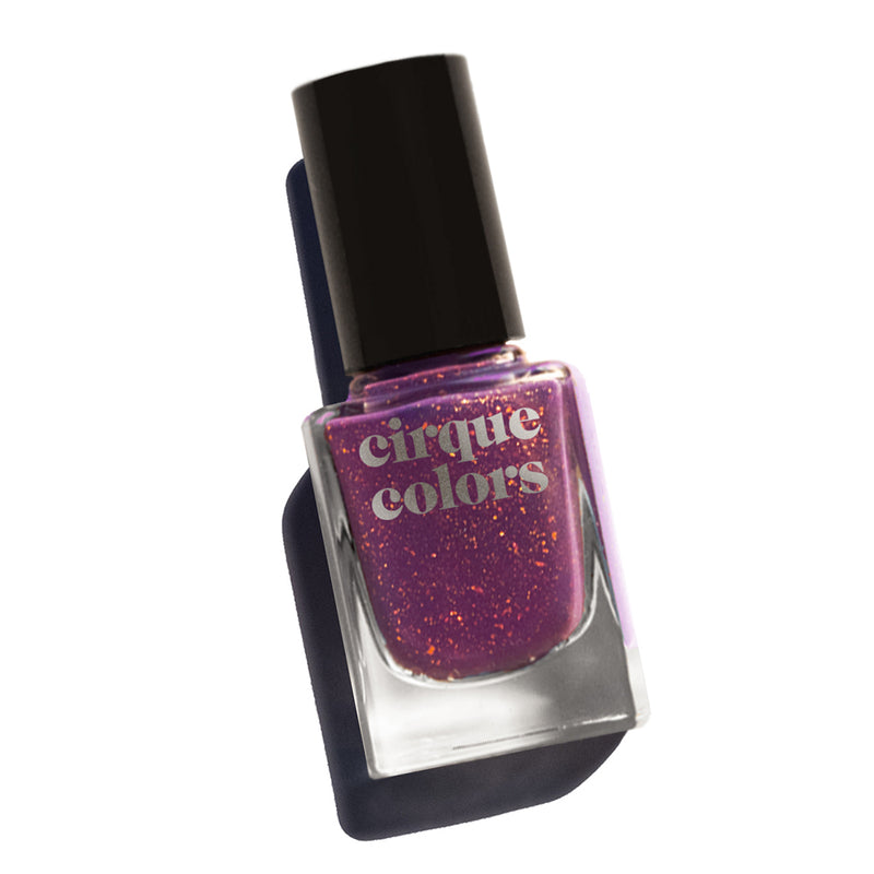 Cirque Colors Izola royal purple nail polish with gold metallic specks Resort Collection