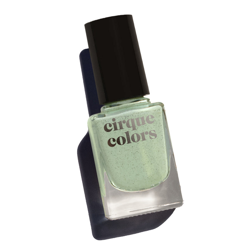 Cirque Colors Paloma dusty sage nail polish with fine black specks Resort Collection