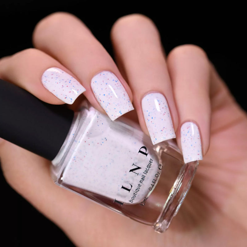 ILNP Liberty creamy white nail polish with blue and red metallic flakies swatch At Sea Collection