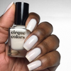 Cirque Colors Linen sheer white nail polish swatch