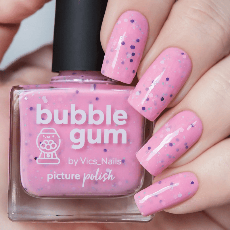 Picture Polish Bubble Gum pink crelly nail polish with purple and white glitter swatch