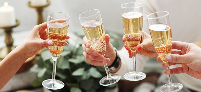 people celebrate with champagne