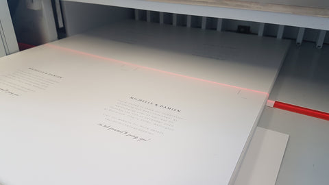 The invitation is printed digitally and then trimmed using a laser to ensure the crop marks are lined up perfectly.