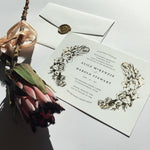 Aureate wedding Invitation is a floral crest semi-custom design. With a handcrafted illustration foil pressed onto luxury card stocks, this invitation is one your guests will love.