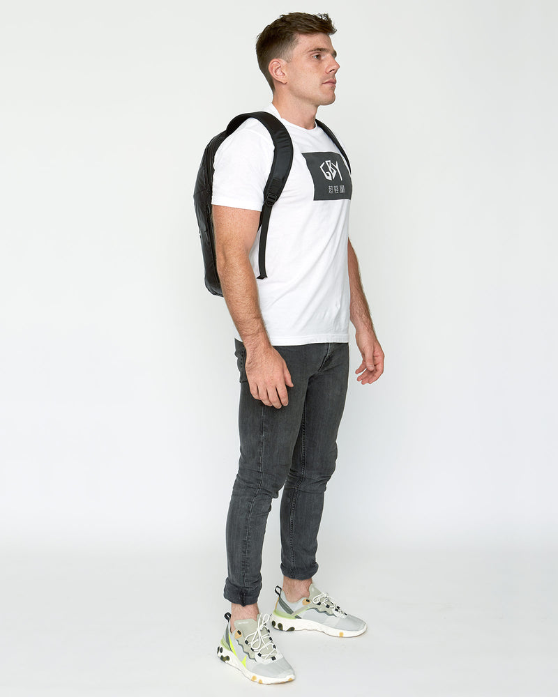 color: black ~ alt: GBY Ultralight Laptop Day Pack Lightest In The World - 3/4 view ~ model_h: 5'11
