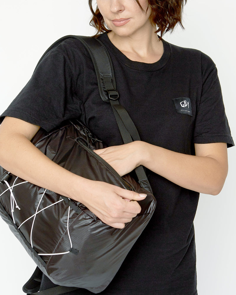 color: black ~ info: Easy access side pocket ~ alt: GBY Ultralight Laptop Day Pack Lightest In The World - Side Pocket Detail ~ model_h: 5'9
