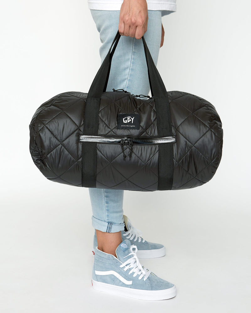 color: black ~ alt: GBY Ultralight - Quilted Gym Duffel Bag ~ model_h: 5'9