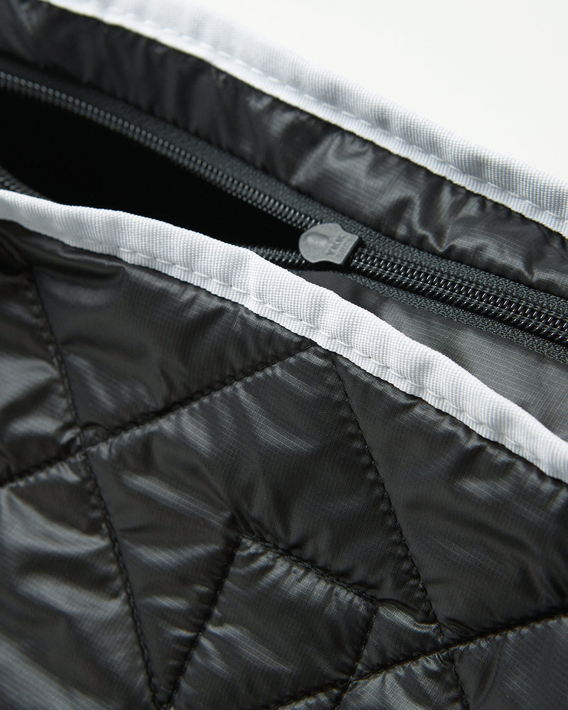 color: black ~ alt: GBY Ultralight - Quilted Gym Duffel Bag Inside Out Detail ~ info: Inside out detail