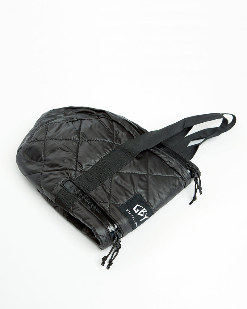 color: black ~ alt: GBY Ultralight - Quilted Gym Duffel Bag Folded 3/4 View