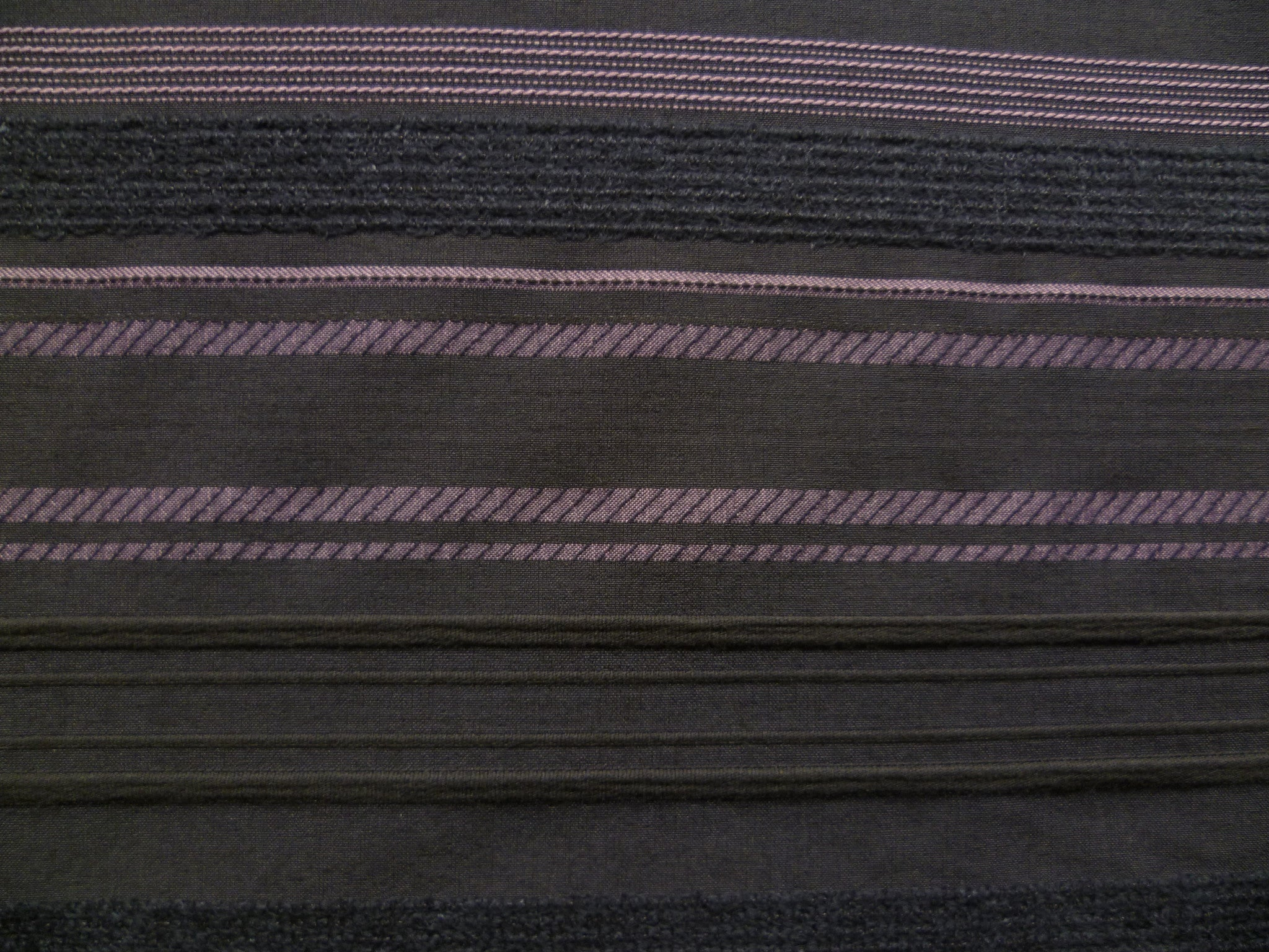 Purple, Grey, And Black Horizontal Stripes On A Black Background.