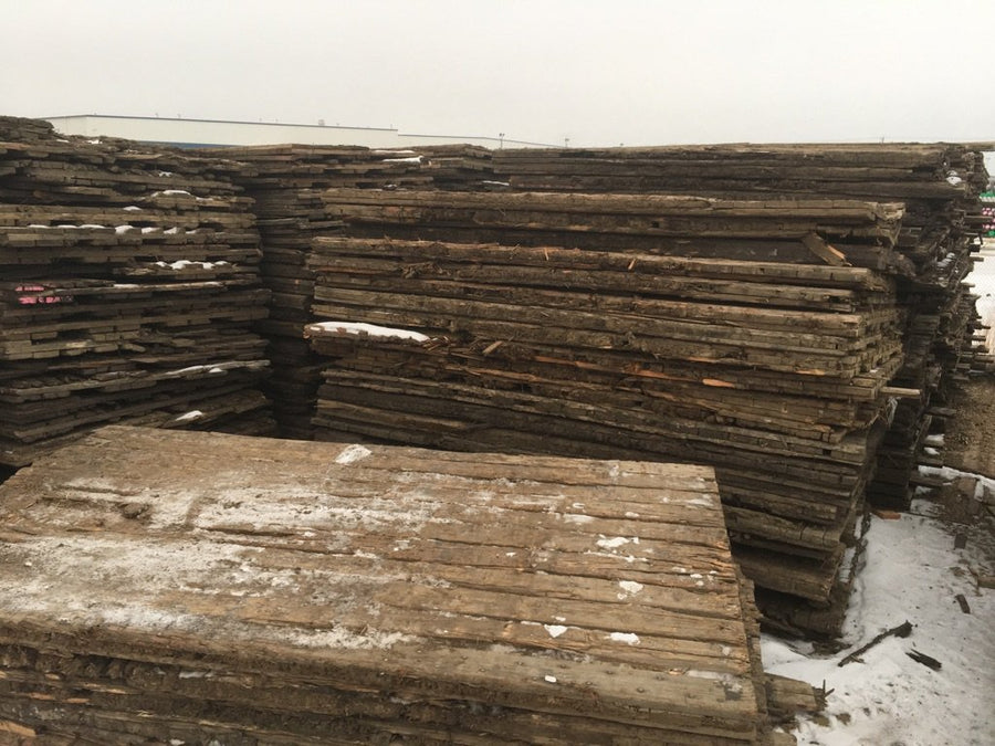 Stacks of well used 3 ply wooden Access Mats / Swamp Mats