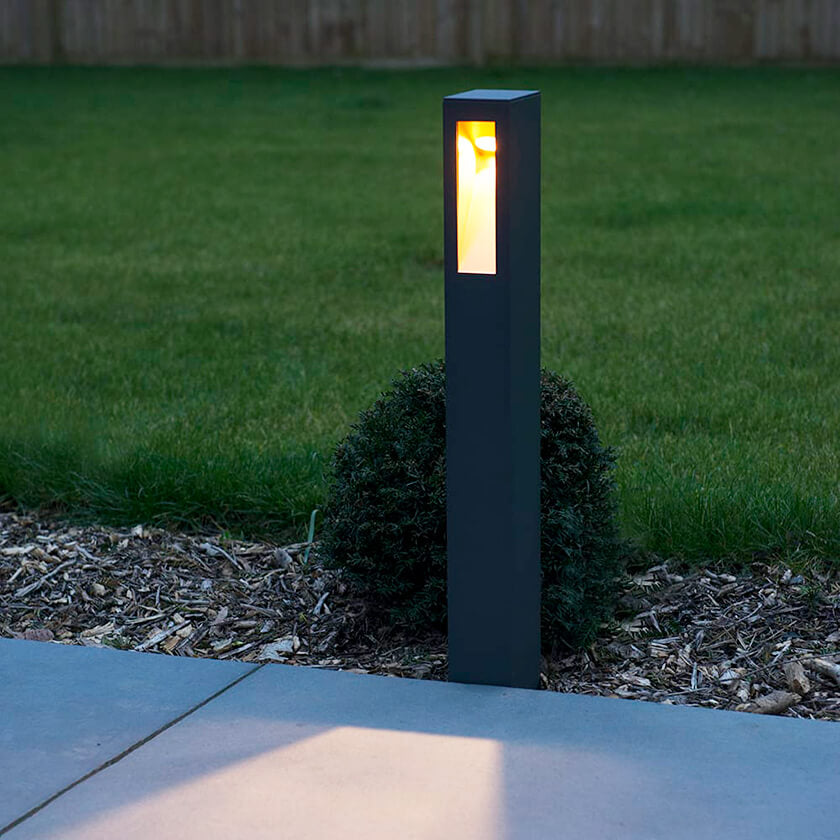 LED light bollard installed in the border of a private garden