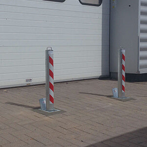 Anti ram raid retractable bollards installed to protect a roller shutter.