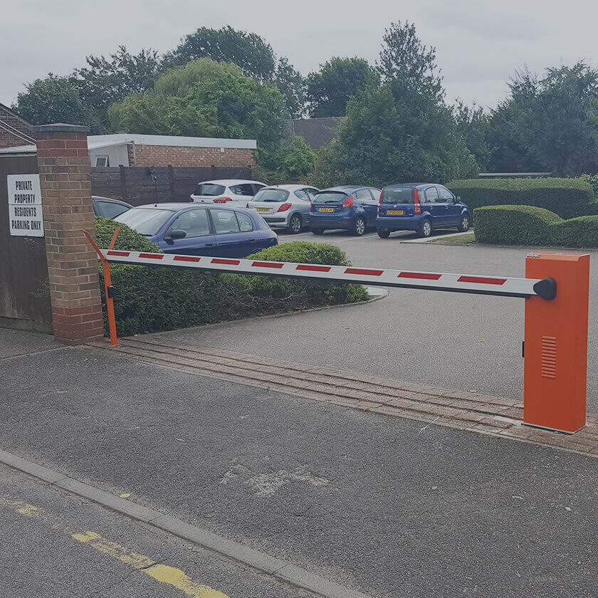 Automatic arm barrier installed to control a residential car park.